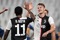 Matthijs de Ligt of Juventus celebrates with Douglas Costa after scoring the goal of 4-0 during the Serie A football match between Juventus FC and US Lecce at Juventus stadium in Turin  ( Italy ), June 26th, 2020. Play resumes behind closed doors following the outbreak of the coronavirus disease. Photo Andrea Staccioli / Insidefoto