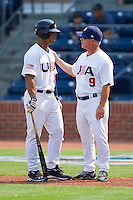 USA Manager Tim Jamieson #9 (Missouri) chats with Chris Elder #12 (Oral Roberts) during the game against the Japan Collegiate National Team at the Durham Bulls Athletic Park on July 3, 2011 in Durham, North Carolina.  USA defeated Japan 7-6.  (Brian Westerholt / Four Seam Images)