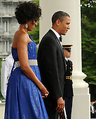 United States President Barack Obama and First Lady Michelle Obama wait to welcome Mexican President Felipe Calderon and Mexican First Lady Margarita Zavala on the North Portico of the White House for a State Dinner in Washington on Wednesday, May 19, 2010.   .Credit: Roger L. Wollenberg - Pool via CNP