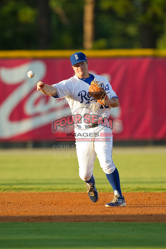 Burlington Royals shortstop Andrew Ayers (18) makes a throw to first base against the Danville Braves at Burlington Athletic Park on August 16, 2013 in Burlington, North Carolina.  The Royals defeated the Braves 1-0.  (Brian Westerholt/Four Seam Images)
