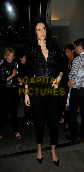 L'Wren Scott, partner of Mick Jagger &amp; former model, is found dead in her New York home on in an apparent suicide on March 17th, 2014.<br /> L'WREN SCOTT<br /> The Daphne fragrance launch party, Dover Street Market, Dover St., London, England.<br /> September 3rd, 2009<br /> full length black leggings jacket ruffled ruffles blouse <br /> CAP/CAN<br /> &copy;Can Nguyen/Capital Pictures