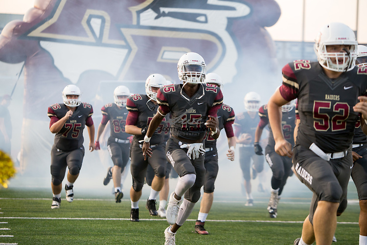The Rouse Raiders take the field for a high school football game between the Rouse Raiders and the East View Patriots at A.C. Bible Stadium in Leander, Texas, on Friday, September 15, 2017.