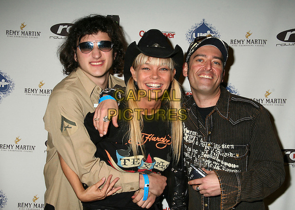 MATT EINSTEIN, JULIE McCULLOUGH & CRAIG ELI.2nd Annual Celebrity Poker Tournament Benefiting The Urban Health Institute at the Playboy Mansion, Holmby Hills, California, USA..April 28th, 2007.half length black cowboy hug embrace hat beige shirt sunglasses shades.CAP/ADM/BP.©Byron Purvis/AdMedia/Capital Pictures