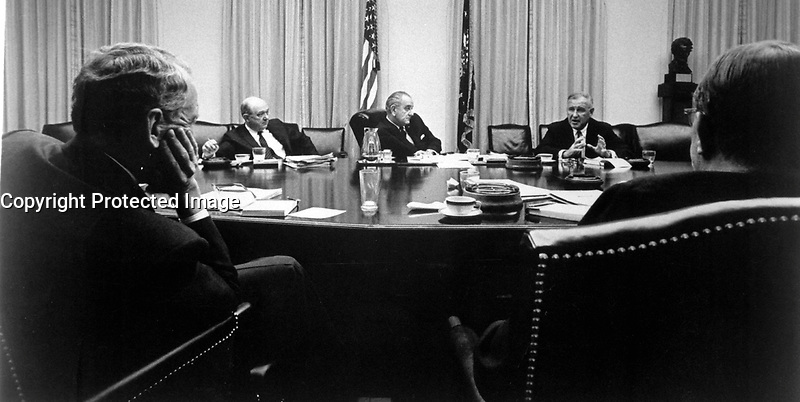 General Creighton W. Abrams, U.S. commander in South Vietnam, discusses the military situation in Vietnam with President Johnson and his advisors October 29 at the White House in Washington.  1968.  White House. (USIA)<br /> NARA FILE #:  306-PSA-68-3528<br /> WAR &amp; CONFLICT BOOK #:  387