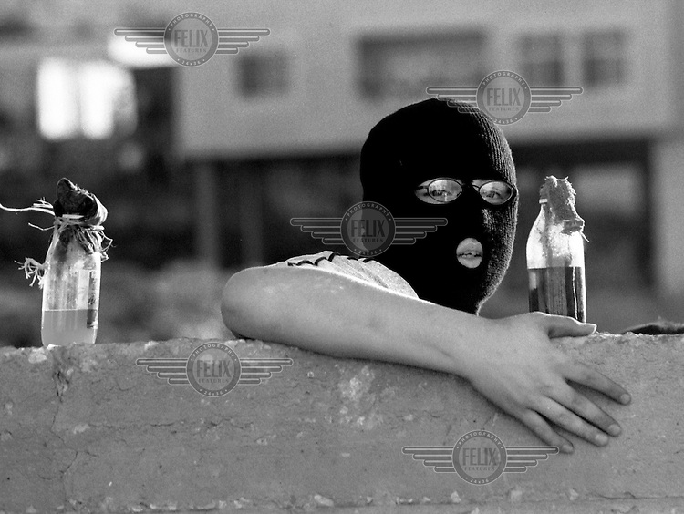 Palestinian with molotov cocktail about to be thrown at Israeli soldiers in Ramallah. Palestine.