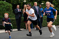 Health and Human Services Secretary Alex Azar(L), Ivanka Trump(2nd L), United States president Donald J. Trump and Herschel Walker(R) watch runners participate in the White House Sports and Fitness Day at the White House in Washington, DC, May 30, 2018. <br /> CAP/MPI/RS<br /> &copy;RS/MPI/Capital Pictures