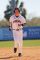 University of Virginia Cavaliers first baseman Pavin Smith(10)  during a game against the Liberty University Flames at Joseph P. Riley Ballpark on February 17, 2017 in Charleston, South Carolina. Virginia defeated Liberty 10-2. (Robert Gurganus/Four Seam Images)