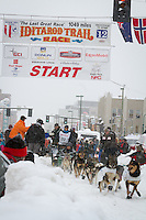 Kelley Griffin leaves the 2011 Iditarod ceremonial start line in downtown Anchorage, during the 2012 Iditarod..Jim R. Kohl/Iditarodphotos.com