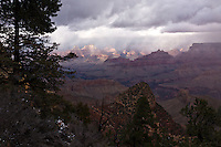 A November storm provides dramatic lighting over the Grand Canyon, seen from the Grandview Trail below the South Rim.