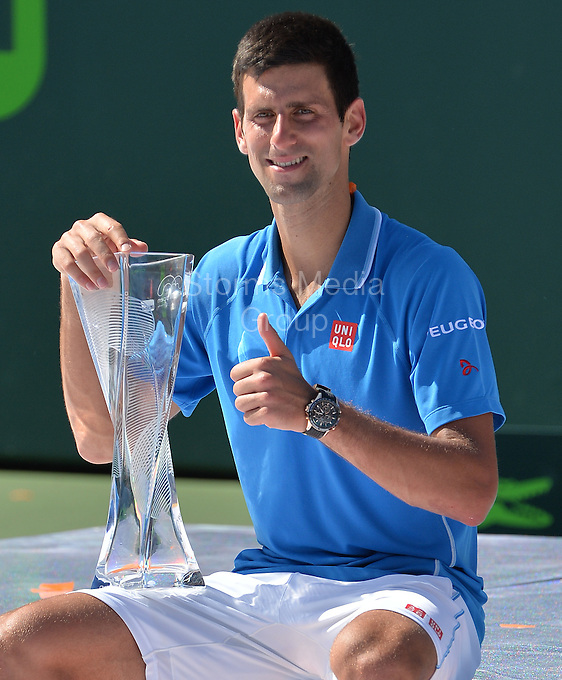KEY BISCAYNE, FL - APRIL 05: Novak Djokovic of Serbia holds aloft the Butch Buchholz trophy after his three set victory against Andy Murray of Great Britain in the mens final during the Miami Open at Crandon Park Tennis Center on April 5, 2015 in Key Biscayne, Florida.<br /> <br /> <br /> People:  Novak Djokovic<br /> <br /> Transmission Ref:  FLXX<br /> <br /> Must call if interested<br /> Michael Storms<br /> Storms Media Group Inc.<br /> 305-632-3400 - Cell<br /> 305-513-5783 - Fax<br /> MikeStorm@aol.com