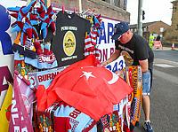 A scarf seller arranges his goods before the match<br /> <br /> Photographer Alex Dodd/CameraSport<br /> <br /> UEFA Europa League - Third Qualifying Round 2nd Leg - Burnley v Istanbul Basaksehir - Thursday 16th August 2018 - Turf Moor - Burnley<br />  <br /> World Copyright © 2018 CameraSport. All rights reserved. 43 Linden Ave. Countesthorpe. Leicester. England. LE8 5PG - Tel: +44 (0) 116 277 4147 - admin@camerasport.com - www.camerasport.com