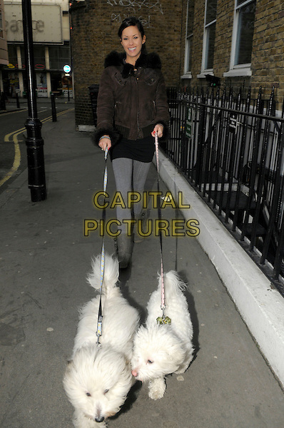 Jessica Jane Clement walking her dogs ( Pants and Knickers ), London, England..30th January 2012.full length dog animal pet leash lead black brown jacket grey gray leggings .CAP/IA.©Ian Allis/Capital Pictures.