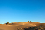 Sahara desert sand dunes with clear blue sky at M'hamid, Morocco.