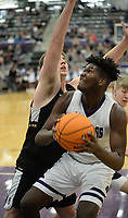 Fayetteville's Tamaury Releford (right) drives to the basket Friday, Jan. 17, 2020, as he is pressured by Bentonville's Brayden Freeman during the first half of play in Bulldog Arena in Fayetteville. Visit nwaonline.com/prepbball/ for a gallery from the games.<br /> (NWA Democrat-Gazette/Andy Shupe)