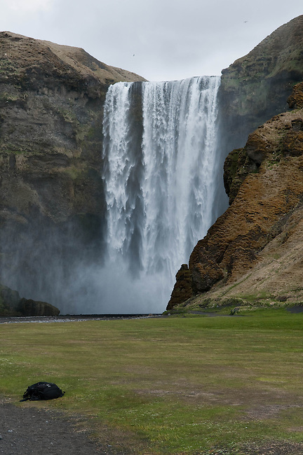 SKOGAFOSS - ICELAND - MAY 09, 2012: Skógafoss is a waterfall at the cliffs of the former coastline situated in the south of Iceland. With a width of 25 m and a height of 60 m it is one of the biggest waterfalls in Iceland. The waterfalls mark the border between the coastal lowlands and the Highlands. (Photo by Dirk Markgraf)