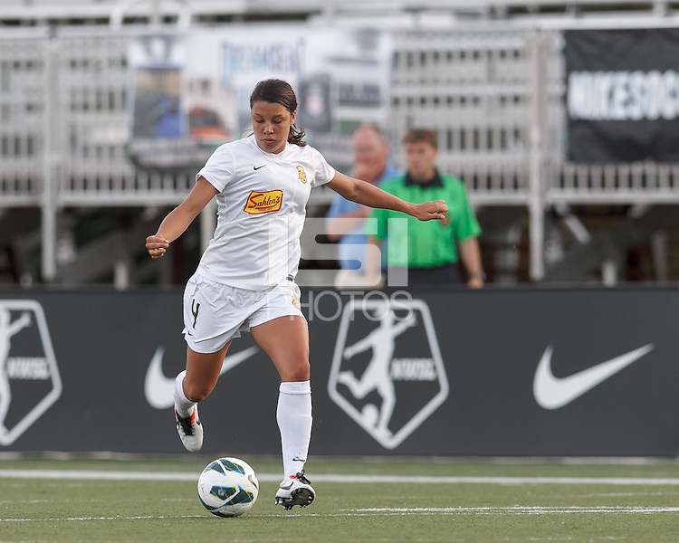 Western New York Flash forward Samantha Kerr (4) passes the ball.  In a National Women's Soccer League Elite (NWSL) match, the Boston Breakers (blue) tied Western New York Flash (white), 2-2, at Dilboy Stadium on June 5, 2013.