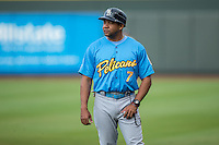 Juan Cabreja (7) of the Myrtle Beach Pelicans coaches first base during the game against the Winston-Salem Dash at BB&T Ballpark on July 7, 2016 in Winston-Salem, North Carolina.  The Dash defeated the Pelicans 13-9.  (Brian Westerholt/Four Seam Images)