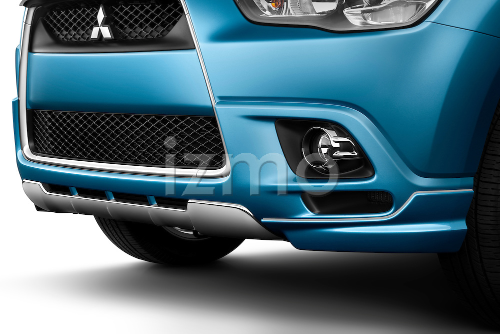 Front grille and fog lamp detail of a 2011 Mitsubishi Outlander Sport SE
