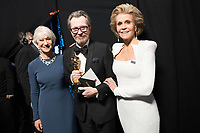 Gary Oldman poses backstage with the Oscar&reg; for performance by an actor in a leading role, for work on &ldquo;Darkest Hour&rdquo; with Helen Mirren and Jane Fonda during the live ABC Telecast of The 90th Oscars&reg; at the Dolby&reg; Theatre in Hollywood, CA on Sunday, March 4, 2018.<br /> *Editorial Use Only*<br /> CAP/PLF/AMPAS<br /> Supplied by Capital Pictures