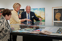 Joan Kessler, Vicki Tracy and Joel Kessler chat about the Cuban memorablilia on display at 'Cuba on My Mind' exhibit, featuring the works of 11 artists, at The von Liebig Art Center, Naples, Florida, USA, March 10, 2011. Photo by Debi Pittman Wilkey