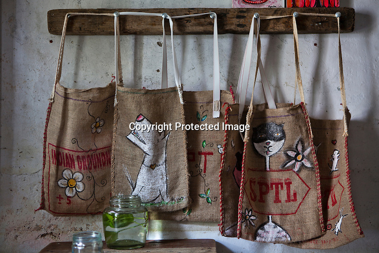 Bags made by the owners (Khor Gaik Ee and Loh Choon Kueng) are displayed for sale at the Amelie Cafe in old part of capital Georgetown of Penang, Malaysia. Photo: Sanjit Das/Panos