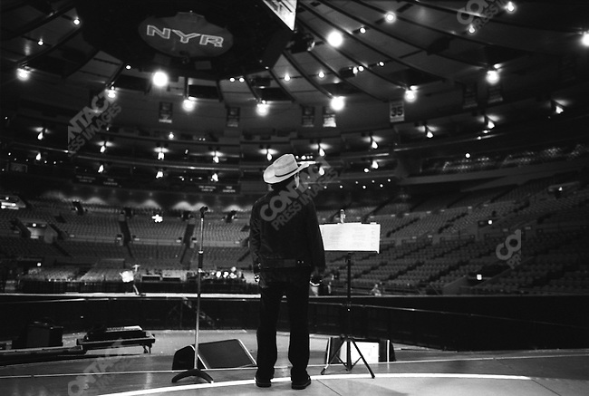 Bono, lead singer of U2 and social activist, at a pre-concert sound check in Madison Square Garden. New York City, October 2005.