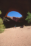 Utah, Coyote Gulch, Jacob Hamblin Arch, Escalante Canyon, Glen Canyon National Recreation Area, Utah, Woman stretching, Maggie Coon, model released,.