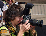 Freelance Photog Nancy Epstein at work during program at the American Airpower Museum at Republic Airport in Farmingdale on September 2, 2005, commemorating the 60th Anniversary of the surrender of Japan that ended World War II. (Newsday Photo / Jim Peppler).