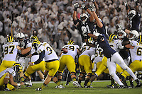 12 October 2013:  Penn State's Nyeem Wartman (5) or Allen Robinson (8) block a field goal in 1st overtime OT. The Penn State Nittany Lions defeated the Michigan Wolverines 43-40 in 4OTs at Beaver Stadium in State College, PA.