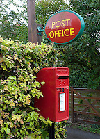 Red post box and Post Office sign, Hanbury, Burton on Trent, Staffordshire.