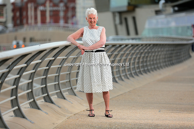 COPY BY TOM BEDFORD<br /> Pictured: Pat Stewart at Blackpool Promenade.<br /> Re: A pin-up girl from the 1950s has returned to the spot where she accidentally flashed her knickers and won the nation's hearts.<br /> Pat Stewart was a teenage dancer when she and a pal were persuaded to pose for a picture on Blackpool seafront.<br /> As the camera clicked a gust of wind lifted her skirt to give just a glimpse of forbidden flesh.<br /> Pat became known as the girl in the spotty dress and it helped kick-off her showbusiness career.<br /> And 65 years later Pat posed on the same spot after returning to Blackpool for the first time since the saucy snap was taken.