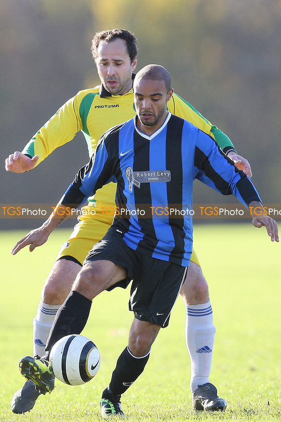 Black Meteors (yellow/green) vs Hackney Borough - Hackney & Leyton Sunday League Albert Daniels Cup Football at South Marsh, Hackney Marshes, London - 27/11/11 - MANDATORY CREDIT: Gavin Ellis/TGSPHOTO - Self billing applies where appropriate - 0845 094 6026 - contact@tgsphoto.co.uk - NO UNPAID USE.