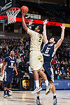 Devin Thomas (2) of the Wake Forest Demon Deacons drives to the basket past Kristijan Krajina (13) of the Mount St. Mary's Mountaineers during first half action at the LJVM Coliseum on November 26, 2014 in Winston-Salem, North Carolina.  The Demon Deacons defeated the Mountaineers 83-49.   (Brian Westerholt/Sports On Film)