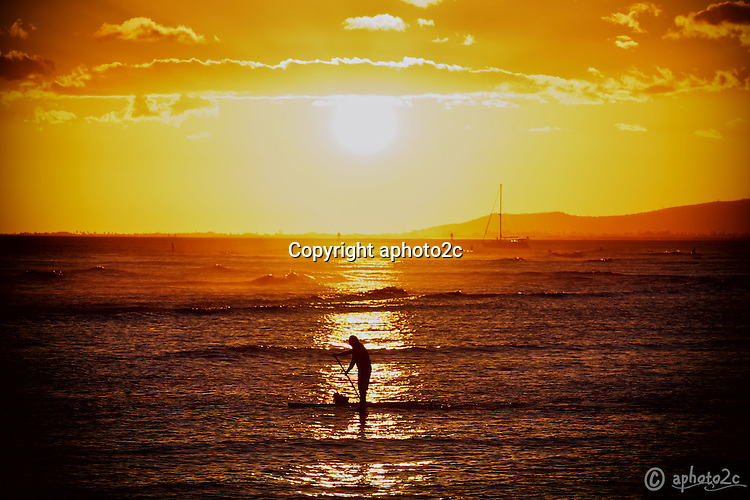 f1e9348391 Photographing a picturesque sunset at Magic Island Oahu, a stand up paddler  moved in front
