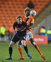 Blackpool's Armand Gnanduillet battles with Doncaster Rovers' Ben Whiteman<br /> <br /> Photographer Dave Howarth/CameraSport<br /> <br /> The EFL Sky Bet League One - Blackpool v Doncaster Rovers - Tuesday 12th March 2019 - Bloomfield Road - Blackpool<br /> <br /> World Copyright &copy; 2019 CameraSport. All rights reserved. 43 Linden Ave. Countesthorpe. Leicester. England. LE8 5PG - Tel: +44 (0) 116 277 4147 - admin@camerasport.com - www.camerasport.com