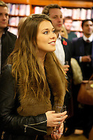 Rebecca Hoffnung listens to Francis Boulle's speech at his book launch of Boulle's Jewels