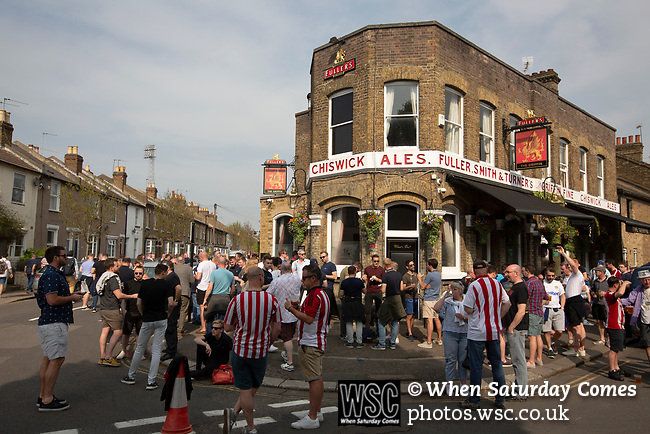 Supporters drinking outside the Griffin pub before Brentford hosted Leeds United in an EFL Championship match at Griffin Park. Formed in 1889, Brentford have played their home games at Griffin Park since 1904, but are moving to a new purpose-built stadium nearby. The home team won this match by 2-0 watched by a crowd of 11,580.