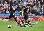Burnley's Johann Guomundsson in action with Crystal Palace's Lee Chung-Yong during the premier league match at the Turf Moor Stadium, Burnley. Picture date 10th September 2017. Picture credit should read: Paul Burrows/Sportimage