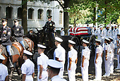 In this hand-out photo released by the McCain family, the horse-drawn caisson bearing the body of Sen. John McCain, R-Ariz., moves through the grounds of the United Sates Naval Academy toward the cemetery after a service in the Chapel Sunday, Sept. 2, 2018, in Annapolis, Md. Credit: David Hume Kennerly / McCain Family via CNP