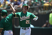 OAKLAND, CA - JULY 17:  Mark Canha #20 of the Oakland Athletics celebrates after hitting a home run against the Seattle Mariners during the game at the Oakland Coliseum on Wednesday, July 17, 2019 in Oakland, California. (Photo by Brad Mangin)