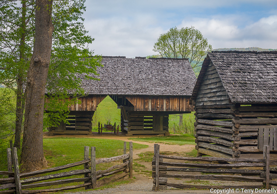 "Great Smoky Mts. National Park, TN/NC<br /> View of a cantilever barn and a log corn crib with a split rail fence at ""The Tipton place"" farm site in Cades Cove"