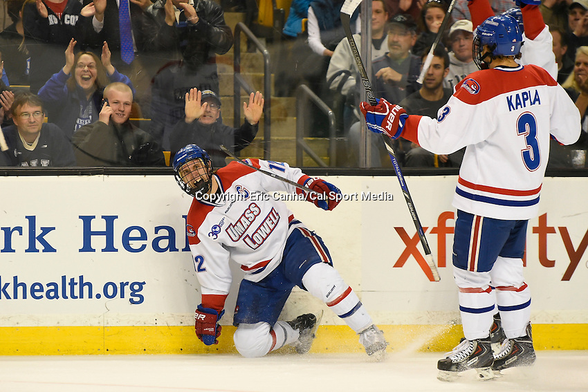 March 22, 2014 - Boston, Massachusetts , U.S. - UMass Lowell's Josh Holmstrom (12) celebrates a goal during the NCAA Hockey East tournament championship game between the University of Massachusetts  and the University of New Hampshire at TD Garden in Boston Massachusetts.  Eric Canha/CSM