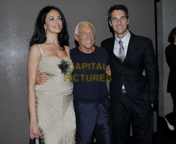 MARIA GRAZIA CUCINOTTA, GIORGIO ARMANI & RAUL BOVA.Armani's Spring-Summer 2007 men's collection, during Milan's fashion shows, Milan, Italy..June 28th, 2006 .Ref: OME.half length black suit jacket blue tee shirt beige dress.www.capitalpictures.com.sales@capitalpictures.com.© Capital Pictures.