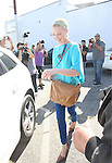April 4th 2012   ...Katherine Heigl  shopping at a fabric store with  her Mom in West Hollywood. Laughing smiling carrying a brown tan Valentino designer purse & aqua blue green shirt ...AbilityFilms@yahoo.com.805-427-3519.www.AbilityFilms.com..