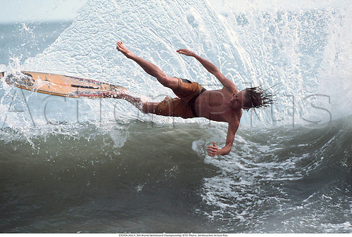 STEVEN JOLLY, 5th World Skimboard Championship, 9707. Photo: JM Mouchet/Action Plus...1997.Surfing.Watersports.Extreme.surfer.surfers.water sport.water sports.watersport.excitement.radical.fun.daring.dare.fall falls off.wipeout wipe out.skim board boards