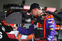 Feb 9, 2008; Daytona, FL, USA; Nascar Sprint Cup Series driver Denny Hamlin (11) inspects his rear wing during practice for the Daytona 500 at Daytona International Speedway. Mandatory Credit: Mark J. Rebilas-US PRESSWIRE