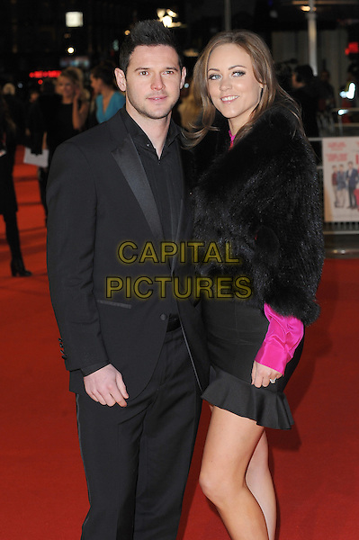 Matt Jarvis & Guest .attends the UK Premiere of 'I Give It A Year', Vue West End cinema, London, England, UK, 24th January 2013..half length black suit fur jacket coat .CAP/BEL.©Tom Belcher/Capital Pictures.