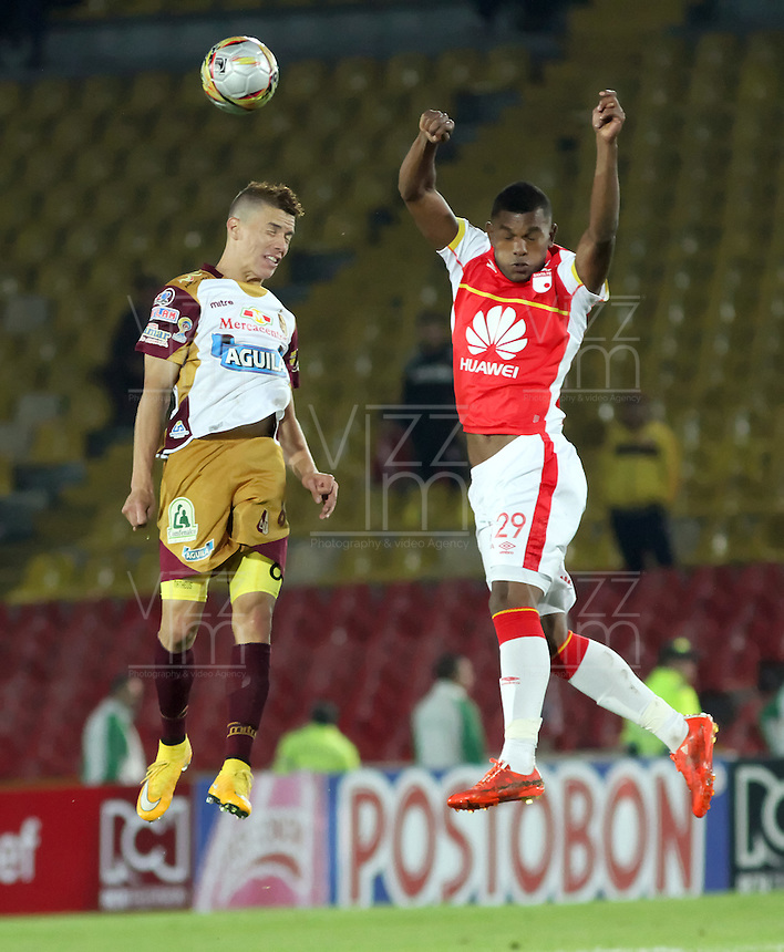 BOGOTA - COLOMBIA - 31-03-2015: Miguel Borja (Der)  jugador de Independiente Santa Fe disputan el balón con Matheus Uribe (Izq) jugador de Deportes Tolima, durante partido adelantado por la fecha 14 entre Independiente Santa Fe y Deportes Tolima de la Liga Aguila I-2015, en el estadio Nemesio Camacho El Campin de la ciudad de Bogota. /  Miguel Borja (R) player of Independiente Santa Fe struggles for the ball Matheus Uribe (L) player of Deportes Tolima, during an advance match of the 14 date between Independiente Santa Fe and Deportivo Independiente Medellin for the Liga Aguila I -2015 at the Nemesio Camacho El Campin Stadium in Bogota city, Photo: VizzorImage / Felipe Caicedo / Staff.