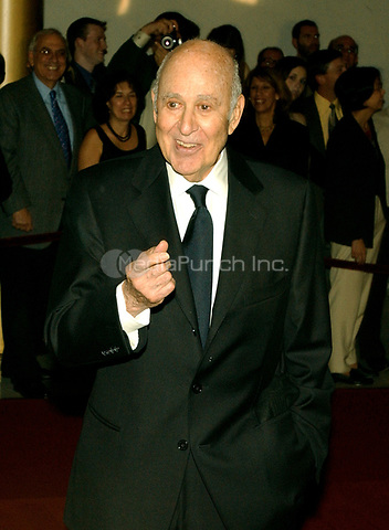 Carl Reiner responds to a reporter's question as he arrives for the eighth annual Mark Twain Prize for American Humor, which is being awarded this year to Steve Martin at the John F. Kennedy Center for the Performing Arts in Washington, D.C. on October 23, 2005.Credit: Ron Sachs / CNP /MediaPunch