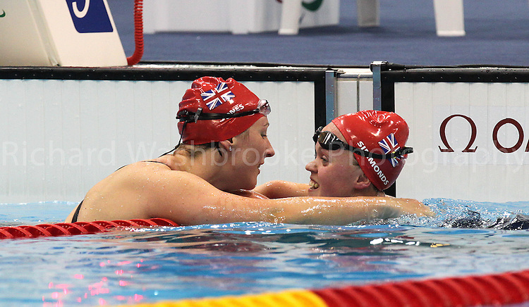 Paralympics London 2012 - ParalympicsGB - Swimming held at the Aquatic Centre 3rd September 2012  .Eleanor Simmonds is congratulated by teammate Natalie Jones after Eleanor wins Gold after competing in the Women's 200m IM - SM6 Final at the Paralympic Games in London. .Photo: Richard Washbrooke/ParalympicsGB